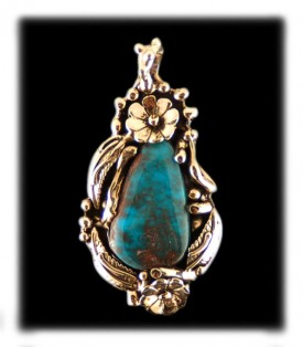 Here is a 14k gold and Bisbee Turquoise necklace
