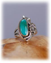 Handmade classic Navajo ladies Turquoise ring made in America with gold, a diamond, and the sky stone