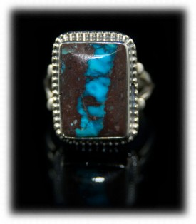 Pictured here is a Navajo native American handmade Bisbee Ribbon Turquoise and Sterling Silver ring