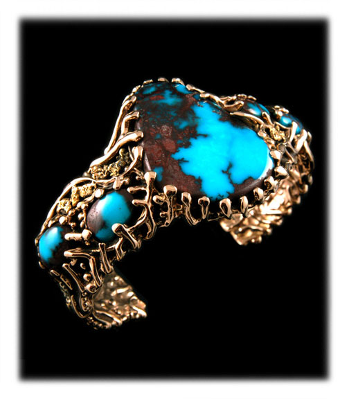 Pictured here is an outrageous American handcrafted mens bracelet by John Hartman just a great example of gold turquoise jewelry by Durango Silver Company of Colorado, USA which would go great with a mens watch