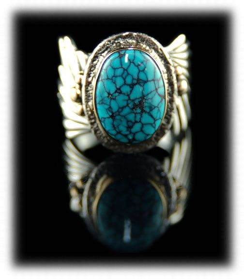 SIlver and Gold ring with Black Number Eight Spiderweb Turquoise Cabochon