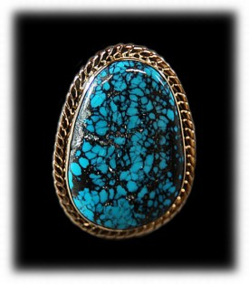 Blue Wind Spiderweb Turquoise in a gold ring