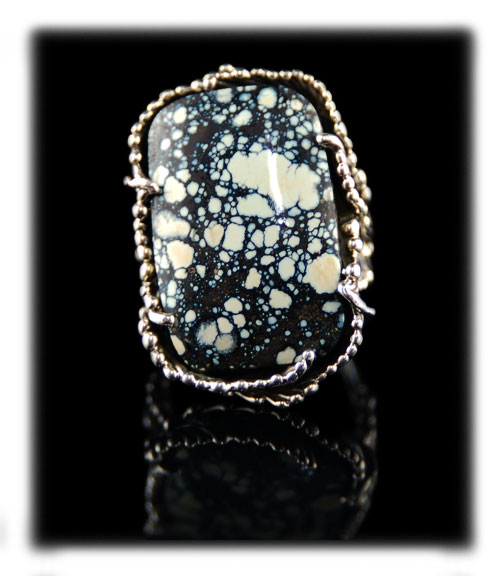 Colorback Spiderweb Turquoise Cabochon in a silver ring