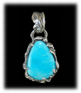 Lost Wax Sterling Silver and Sleeping Beauty Turquoise amulet