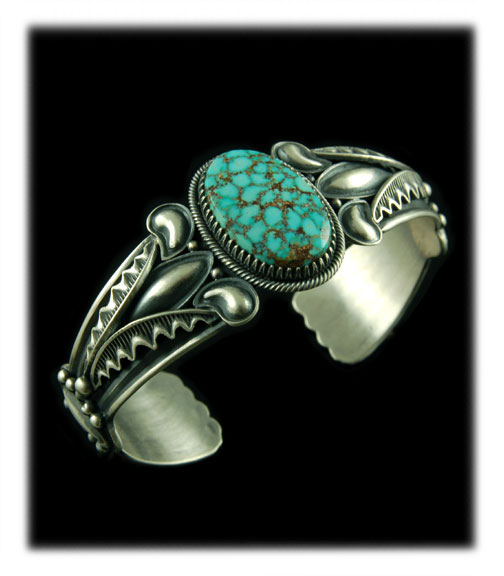 A Kingman Spiderweb Turquoise  cabochon in a silver bracelet