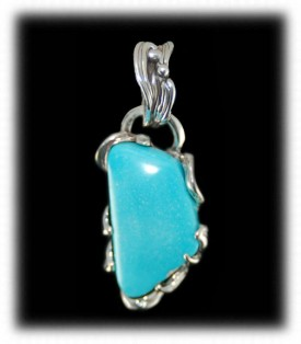 Hand carved Sterling Silver and Sleeping Beauty Turquoise pendant