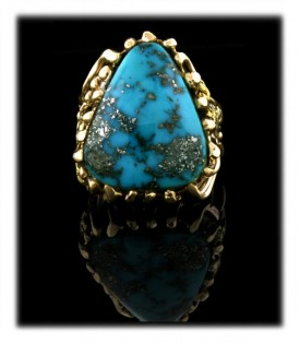 Shown here is a fine example of a Morenci Turquoise Mens Gold Ring which is a one of a kind work of art by the Hartman family