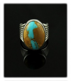 Here is a fine example of a handmade Sterling Silver and Ribbon Turquoise Ring