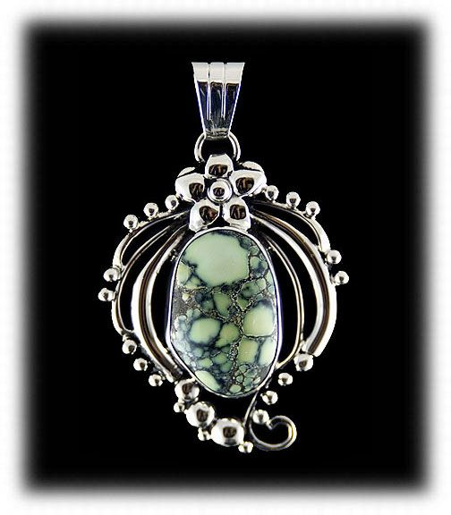 Tortoise Spiderweb Turquoise Cabochon in a Sterling Silver amulet