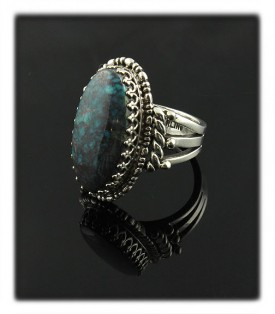 Pictured here is a wonderful handmade Sterling Silver ring with natural Bisbee Turquoise from Arizona, USA by John Hartman